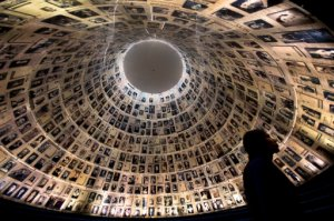 A visitor walks at the Hall of Names at the Yad Vashem Holocaust memorial in Jerusalem, ahead of Holocaust Remembrance Day,