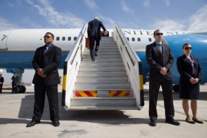 U.S. Secretary of State John Kerry climbs up the stairs of the plane to leave Tel Aviv this week.