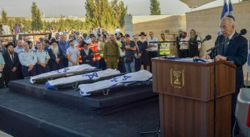 """Gil-Ad Shaer, Naftali Frenkel and Eyal Yifrach are  laid to rest side-by-side in Modi'in cemetery on Tuesday evening, a day after their bodies were found in the West Bank and 19 days after they vanished while hitchihiking near Hebron. President Shimon Peres spoke at the funeral saying, """"To all those who wish to vanquish us, I want to say that terror is a boomerang. It's targeted against us but hits its instigators. We bow our heads but won't lose our soul. I know that security forces will catch the murderers and they will be brought to justice."""""""